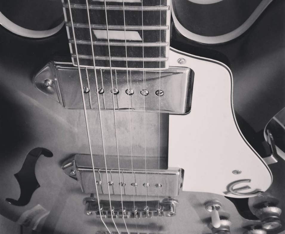 Close-up of a guitar in black & white